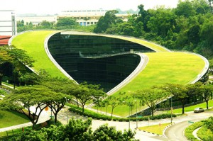 A swirling green roof tops the gorgeous Nanyang Technical University in Singapore